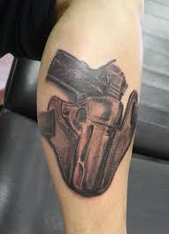 veritas gun tattoo design on arm photos pictures and sketches