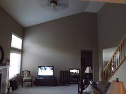 decorating tall walls decorating a large wall with a slanted ceiling how to decorate