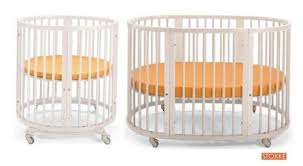 beautiful oval  round baby cribs for unique nursery decor with this fully convertible crib courtesy of stokke begins as fully round  structure with included from homestratospherecom