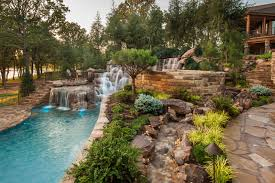Rustic Landscaping Ideas by Mountain Mine Themed Pool With Waterfalls Slide And More Rustic