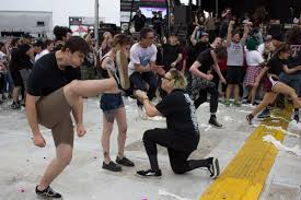 Mosh Pit Meme - this proposal in a mosh pit has become a meme for all the wrong