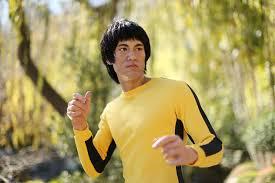 bruce yellow jumpsuit bruce s shrunken yellow jumpsuit goes the hammer