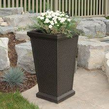 Tall Plastic Planters by Vista Planter Resin Wicker Round Round Planters Pinterest