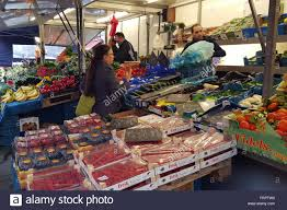 brussels belgium 23rd mar 2016 locals shop for food at the
