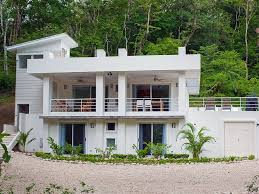 newer two story four bedroom house with pool green roof and