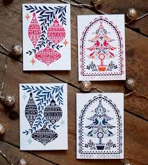 set of eight folk tree and bauble cards by pepper print