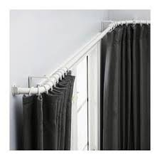 hanging curtains on angled windows window wall window and walls