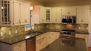 granite countertop distressed antique white kitchen cabinets