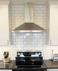 village home stores geneseo kitchen with stainless hood and subway tile all the way ceiling