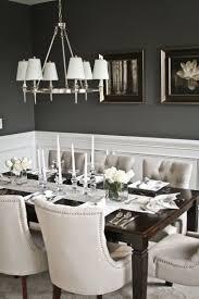 dining rooms metalic chandelier dark gray walls candlesticks