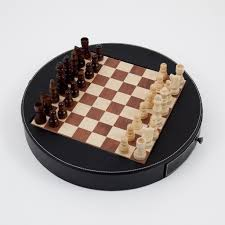 unique chess set w black leather wrapped around the playing board