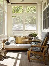 back porch covered screened patio with teak sofa yellow