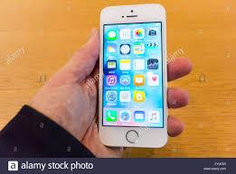 paris apple store paris france detail close up man u0027s hand holding iphone se