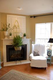 i like the shutter above the mantel could cover a niche mantels