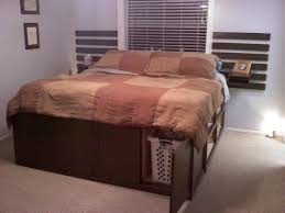 bedroom brown wooden kingsize bed frame with storage and wall