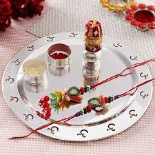 traditional bhaiya bhabhi rakhi set with silver plated puja thali