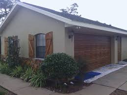 wooden garage doors with windows faux wood garage door matching window shutters ocala faux finish
