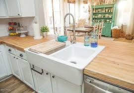 white kitchen cabinets with butcher block countertops butcher block countertops pros and cons bob vila