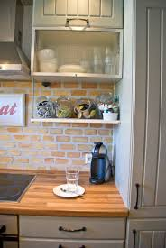 tiles backsplash open shelf beneath cabinets with brick open shelf beneath cabinets with brick backsplash and butcherblock countertops pudel design featured on remodelaholic kitchen terminai page small modern