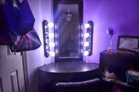 bedroom black wooden corner makeup vanity with mirror and light