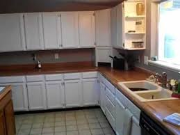 how to paint kitchen cabinets white before and after painting oak kitchen cabinets white high
