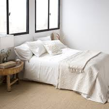 embroidered egyptian percale bedding with a pompom mid season
