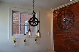 industrial pulley pendant light 16 creative handmade industrial lighting ideas for your interior