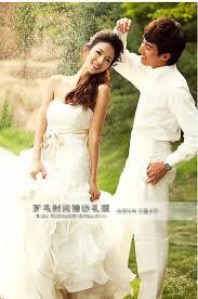 white color sweetheart cascading ruffle mermaid wedding dress