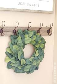 make a magnolia wreath using faux leaves from michaels magnolia