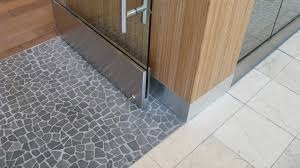 black flat pebble floor store entrance modern entry hawaii