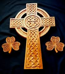 wooden celtic cross wood carving of celtic cross and shamrocks with knotwork celtic
