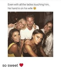 even with all the ladies touching him his hand is on his wife so