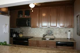 how to paint over stained cabinets paint or stain kitchen cabinets alder wood chestnut prestige door