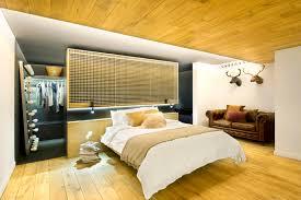 closet behind bed bajo comercial convertido en loft egue y seta archdaily