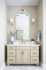 cream bath vanity with keyhole mirror transitional bathroom