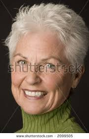 cute hairstyles for 60 yr old stock photo head shot of a beautiful 55 to 60 year old woman