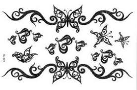 tribal butterfly tattoo set for lower back