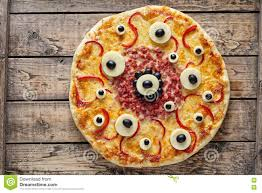 halloween header background halloween scary food monster pizza with eyes on vintage wooden