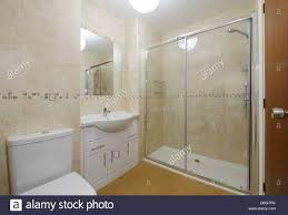 modern small bathroom with toilet basin and shower stock photo