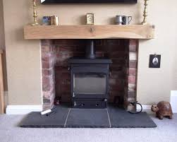 brick fireplace oak beam with black indian stone hearth woodwarm