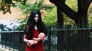 cosplayer as scary character of in bloody red dress alma