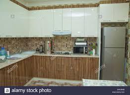 white kitchen cabinets design brown and white kitchen design refrigerator modern