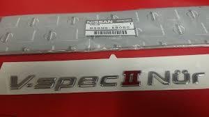 nissan frontier emblem genuine jdm nissan r34 v spec ii nur emblem u2013 nissan race shop