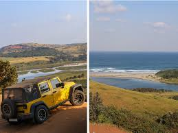yellow jeep on beach xolobeni by jeep never settle