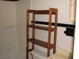 Bathroom Shelf Over Toilet by Wood Over Toilet Shelf And White Subway Bathroom Backsplash Tile