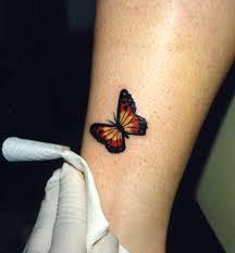 orange winged monarch butterfly leg tattoos butterfly
