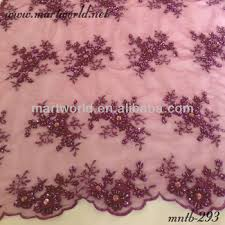 red embroidery design with beads and sequins in wedding dress lace