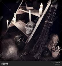 scary mystic ritual with human skull candles and evil staircase
