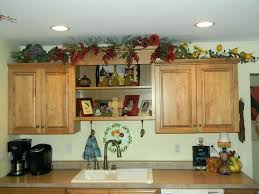 above kitchen cabinet storage ideas decorating ideas above kitchen cabinets advertisingspace info