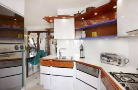 small apartment kitchen design with wall mounted cabinets and open